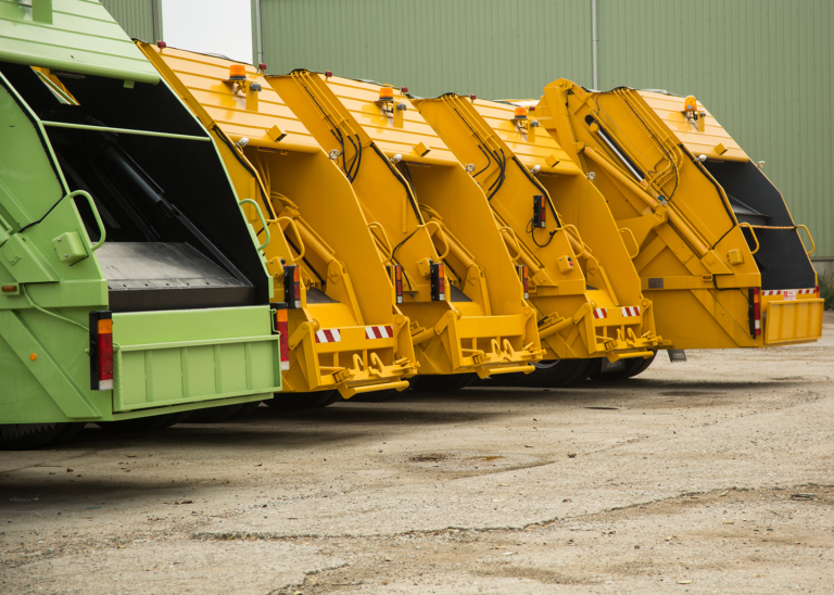 Yellow and green recycling trucks using Cypress VUE